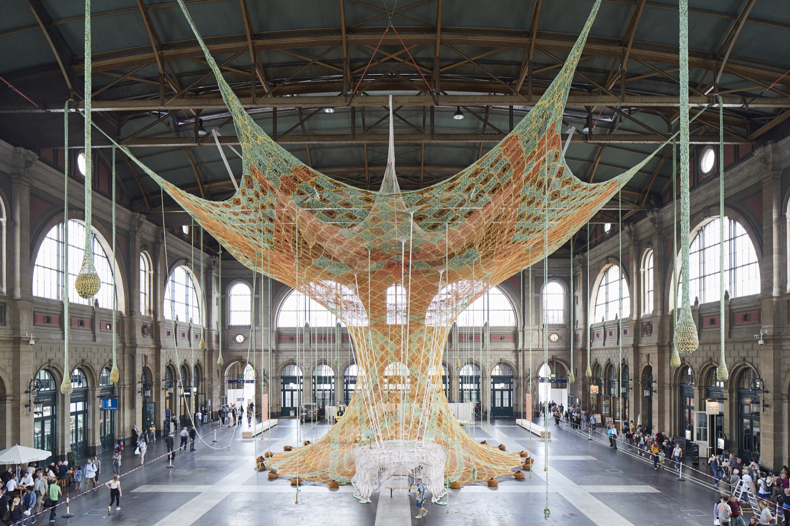 Massive tree-like sculpture takes over Switzerland's largest train station