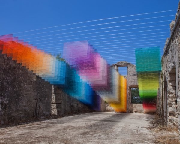 brightly colored mesh panels installed in greek ruins