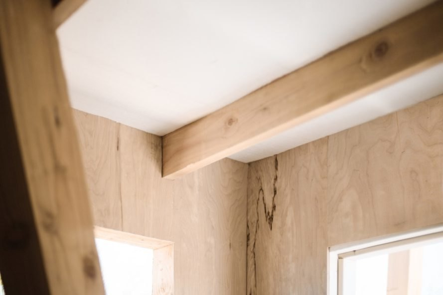 close up of exposed wooden ceiling beams inside the cabin