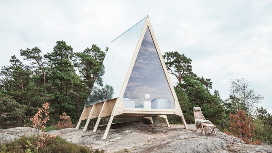 a-frame cabin with all glass facade