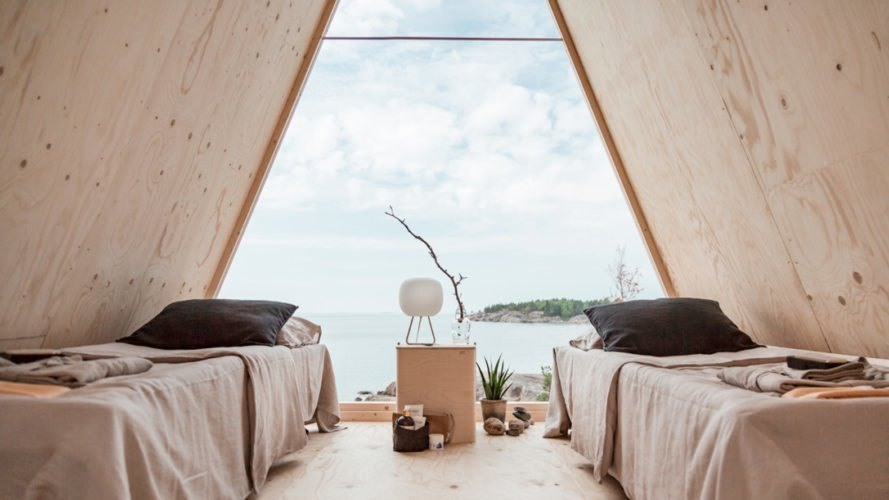 interior images of a-frame cabin with two beds
