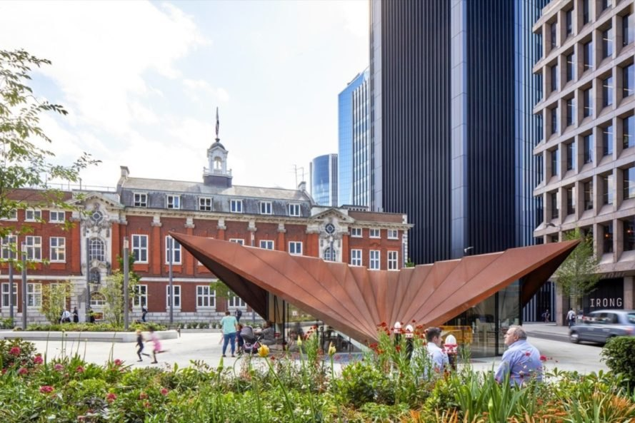 pavilion with reddish weathered steel folded roof