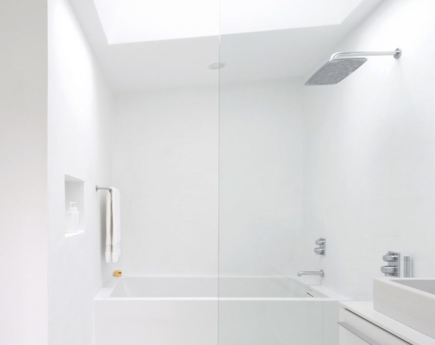 All-white bathroom with large showerhead