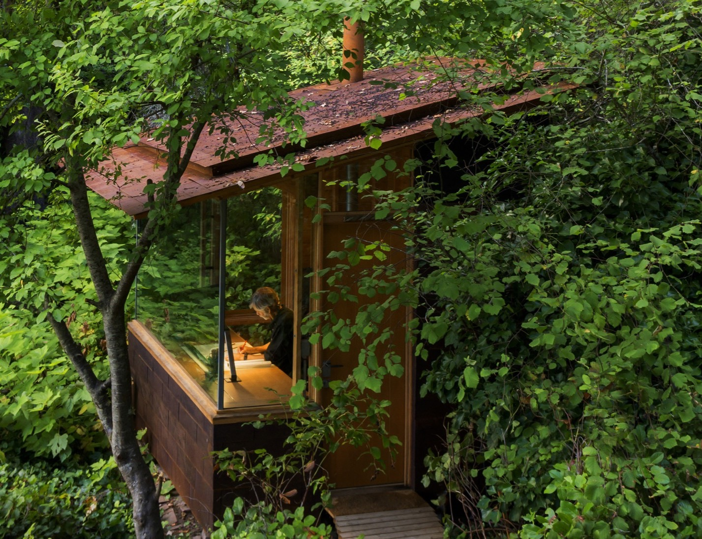 This cozy cabin in the woods was once just an old tool shed