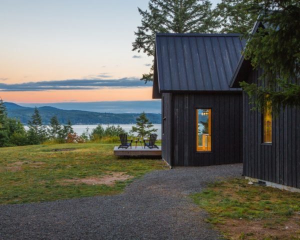 cabins with view of water in background