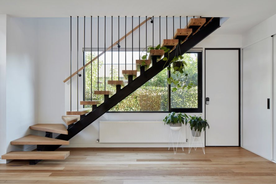Wooden staircase in front of window