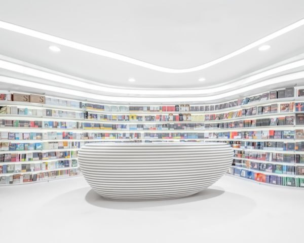 all white library with curved bookshelves