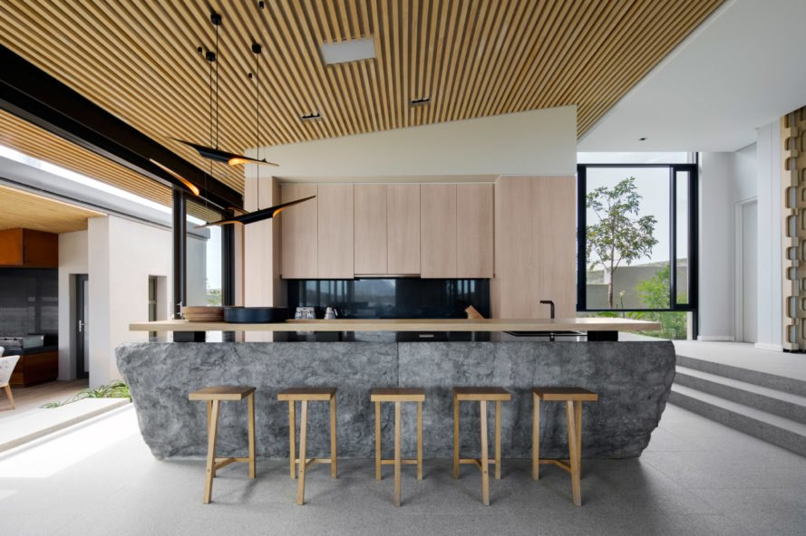 Kitchen with granite island and wooden stools