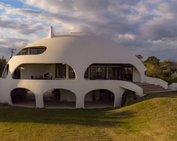 white dome shaped house with lawn