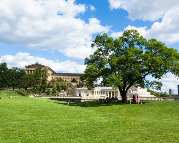 Philadelphia art museum park with people lounging in the grass