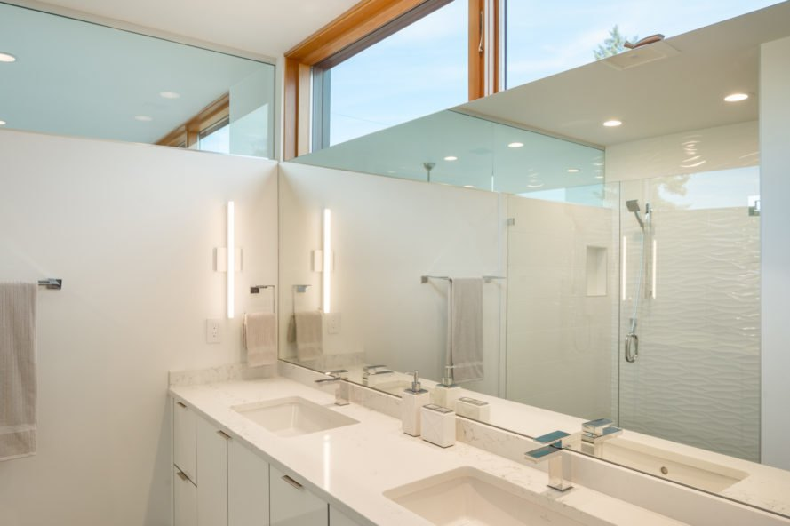 Bathroom with all white decoration and windows at top