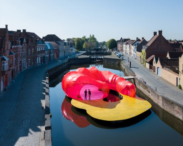 Pink and yellow floating pavilion in Bruges canal