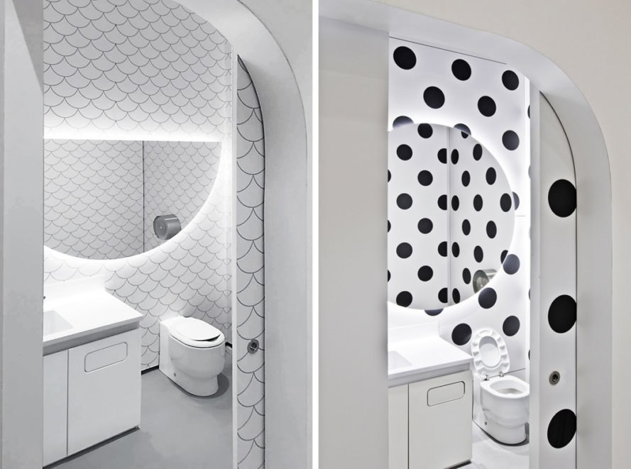 children bathrooms with scalloped tiles and black and white polka dot wallpaper