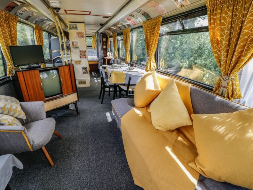 Vintage Red Double Decker Bus Is Converted Into A Retro Hotel