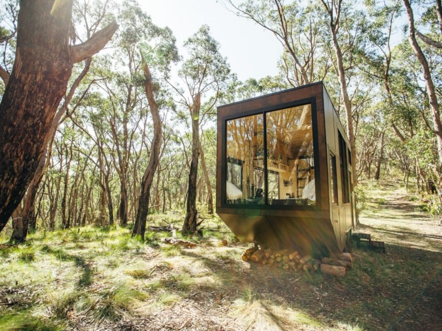 tiny wooden cabin with large front window