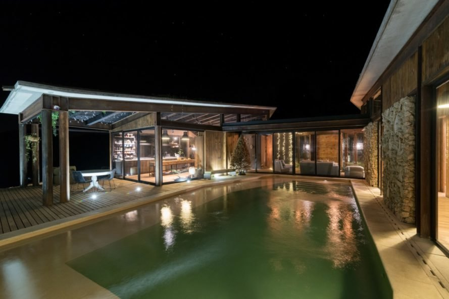 night scene of home with pool
