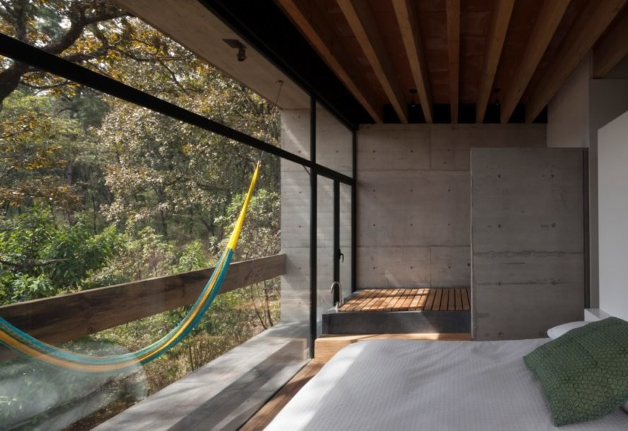 a bedroom with hammock and floor-to-ceiling walls