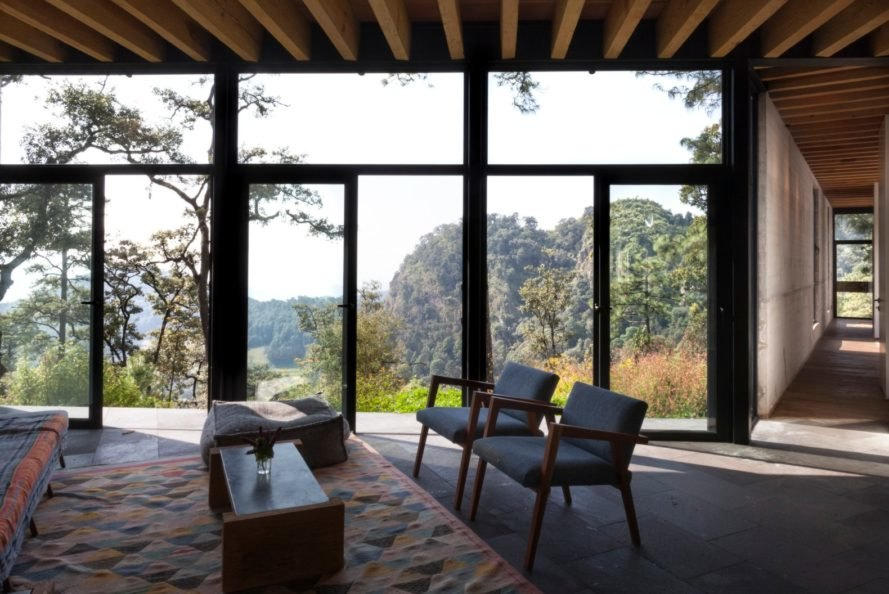 an interior living spac with floor to ceiling windows