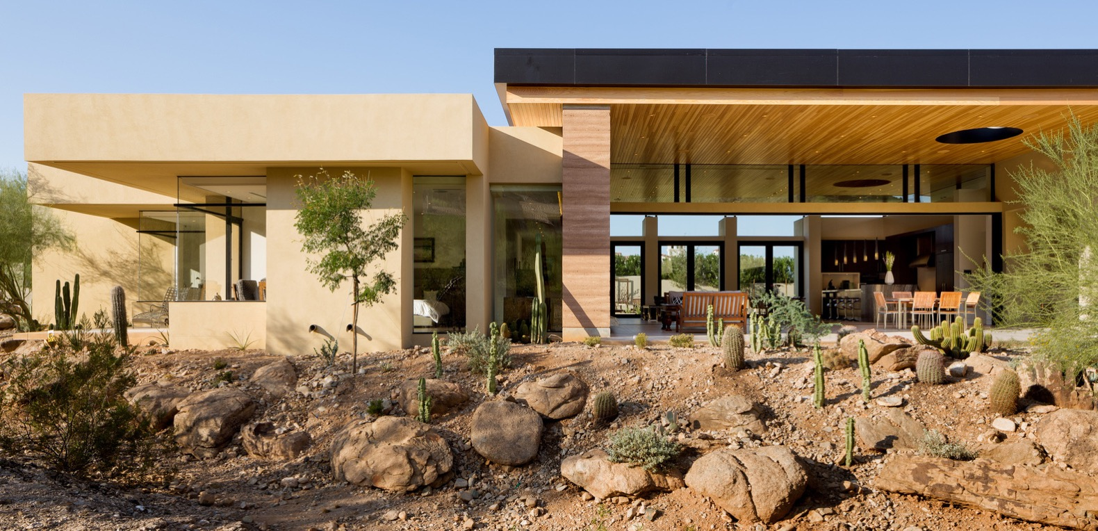 Rammed earth walls tie this modern home to the Arizona desert landscape