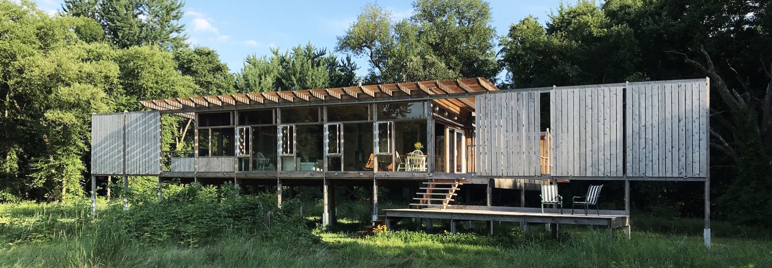 Off Grid Glass Cabin On A Prairie Is Built Of Recycled