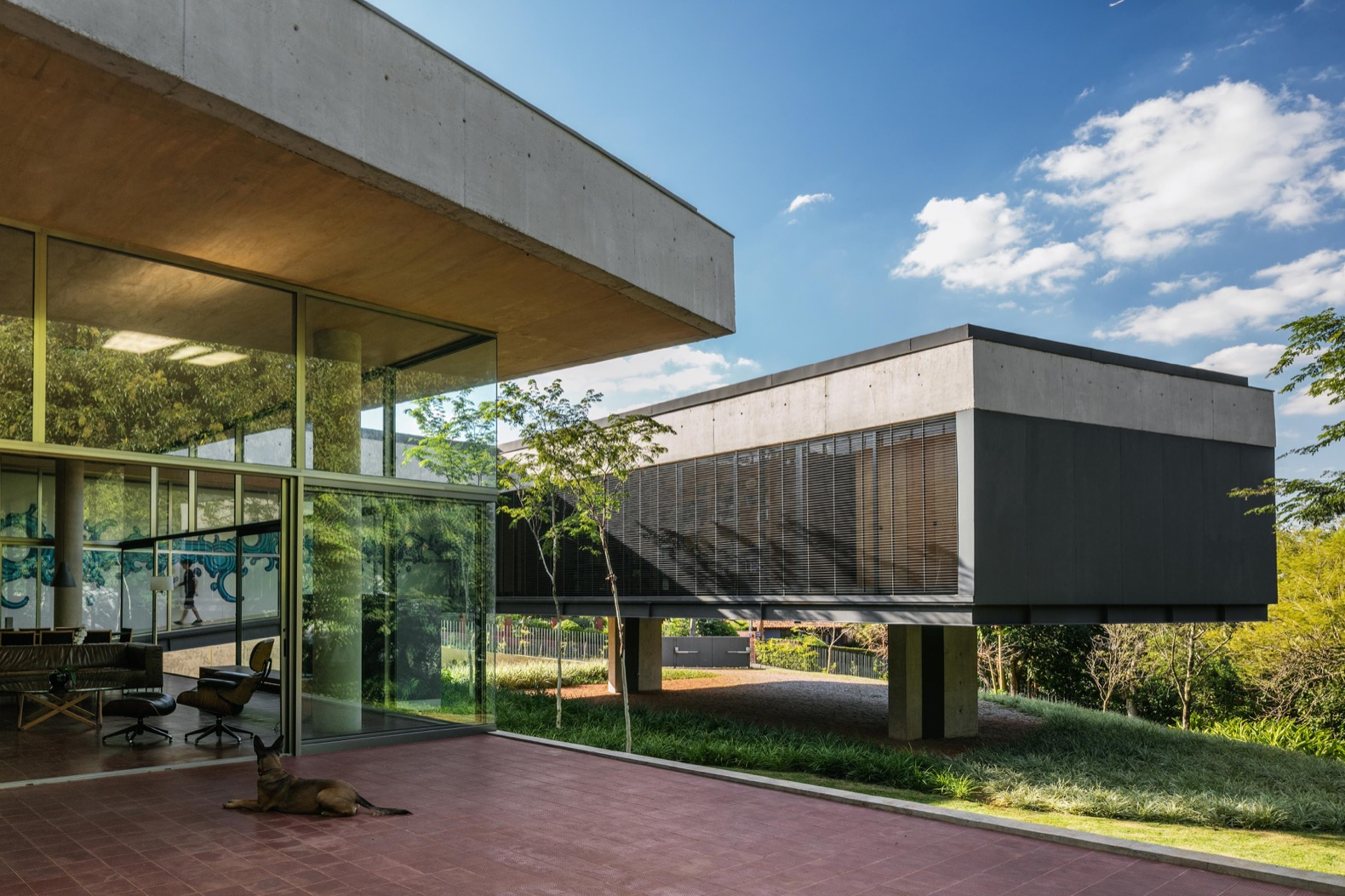 Massive green-roofed home in Brazil features a series of ramps