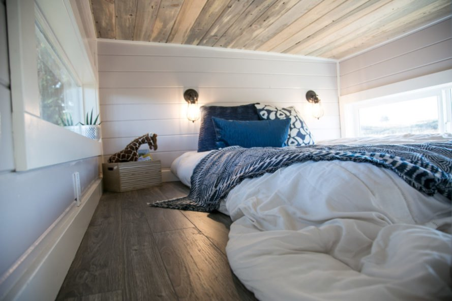 large bed on wooden floors