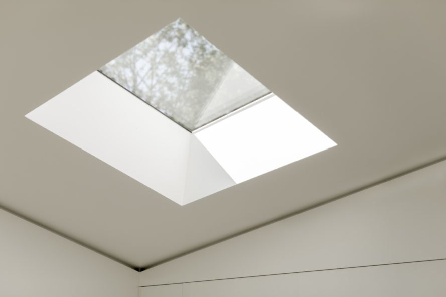 a skylight in a white ceiling