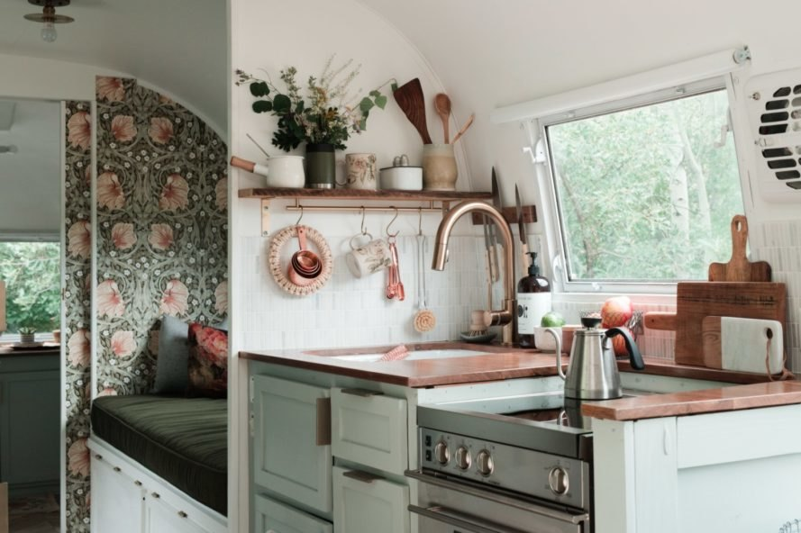 Airstream kitchen with brass accents