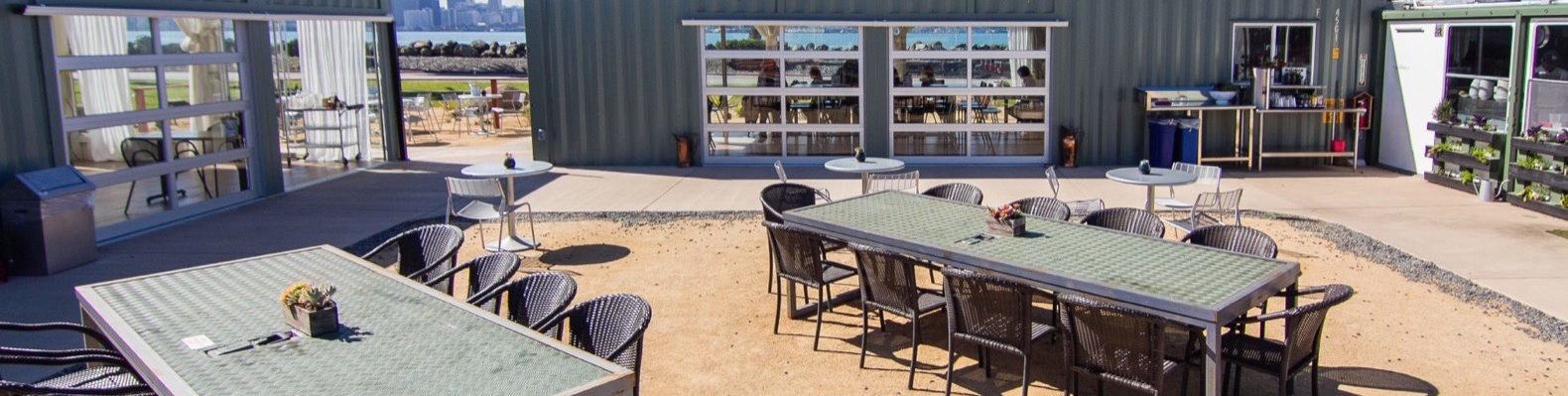 outdoor dining area surrounded by shipping containers