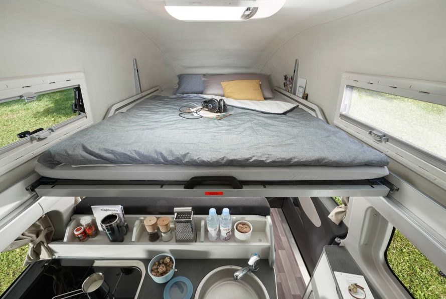 bed in the roof of a camper van
