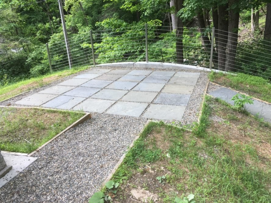 a walkway with concrete panels