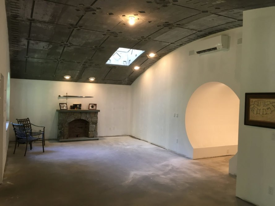 a living area with curved roof and arched doorways
