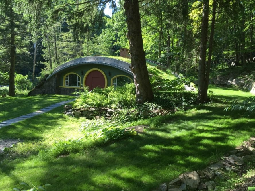green hobbit home with green roof