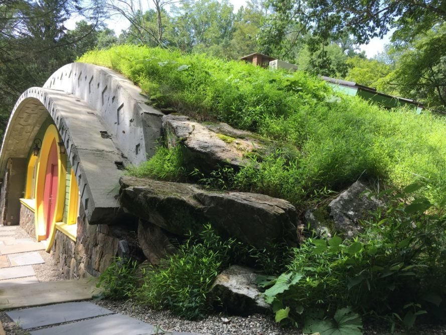 Curved stone home with green roof
