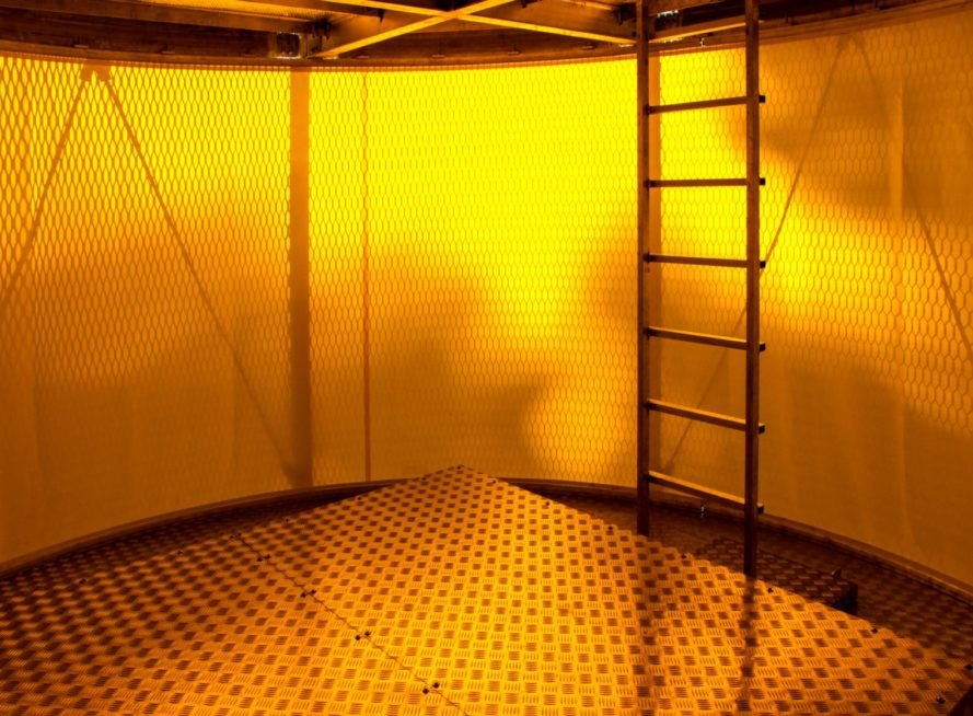 yellow-hued round interior with ladder