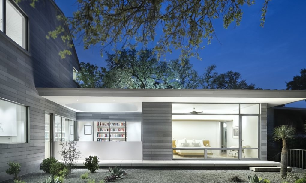 Solar powered austin home can save nearly 100k in energy for Can you build a house for 100k