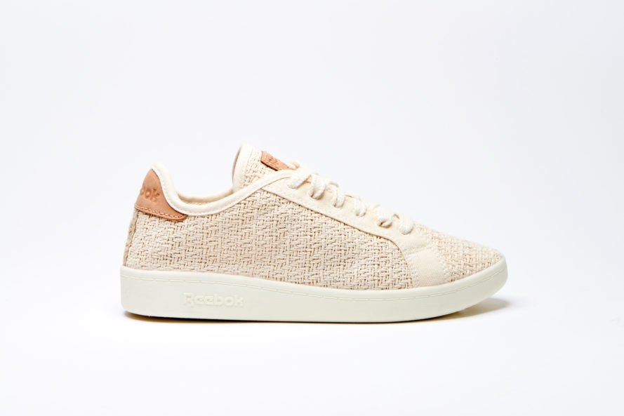 Side view of light tan Reebok sneaker