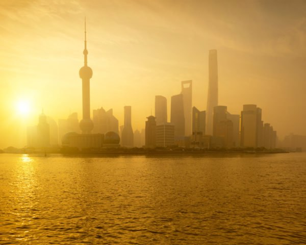 Shanghai skyline in a yellow fog at sunset