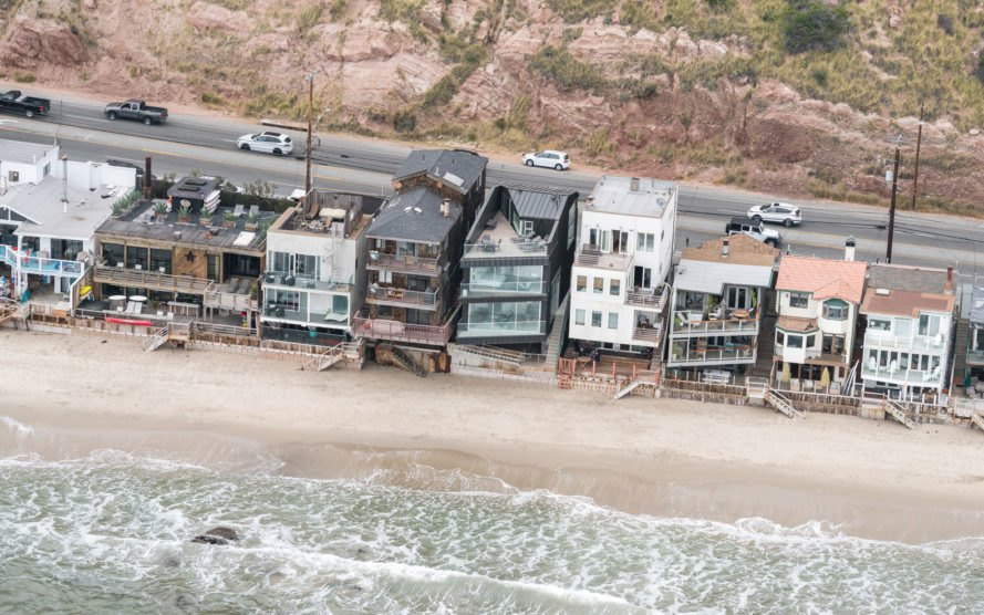 Aerial view of the dark home and nearby beach homes