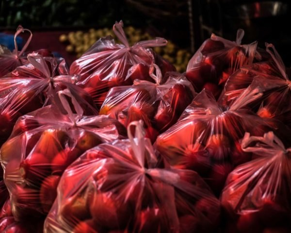 red plastic bags filled with fruit