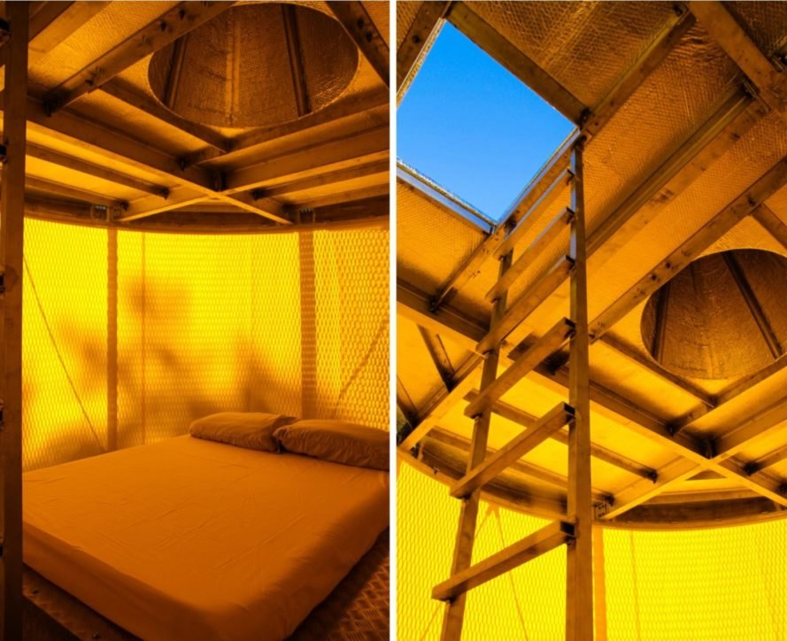 yellow-hued interior with ladder leading out to a rooftop deck