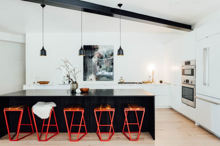 orange stools in front of kitchen island