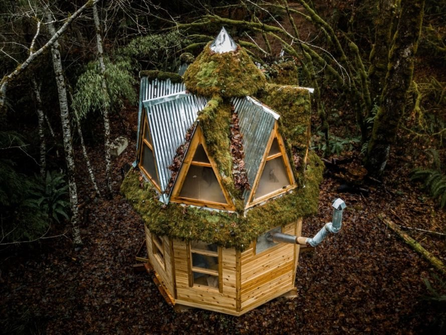 aerial shot of tiny cabin with multiple a-frame roofs