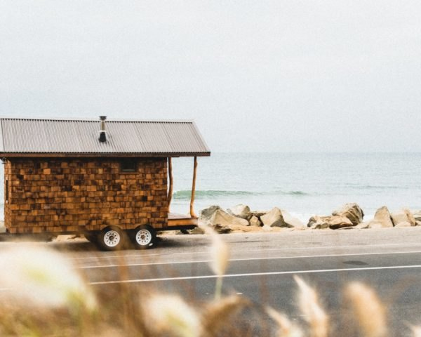 tiny home on wheels with cedar siding near the beach