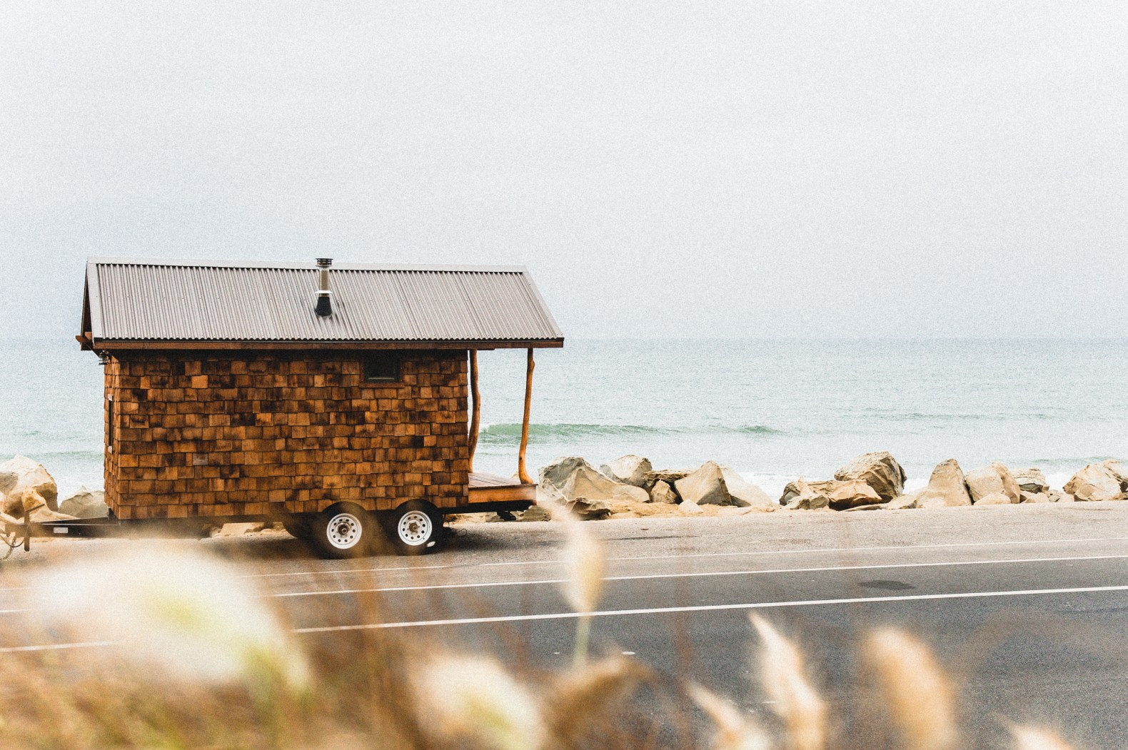 The adorable Acorn tiny cabin is made of wood salvaged from an old mansion