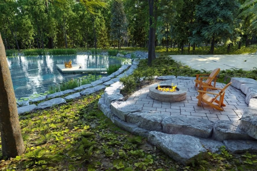 ourtoodr stone patio with wood chairs and firepit in front of human-made pond
