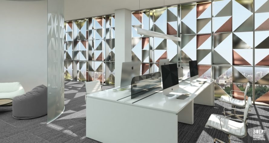 large white desks and chairs with a wall of glass featuring aluminum triangle patterns