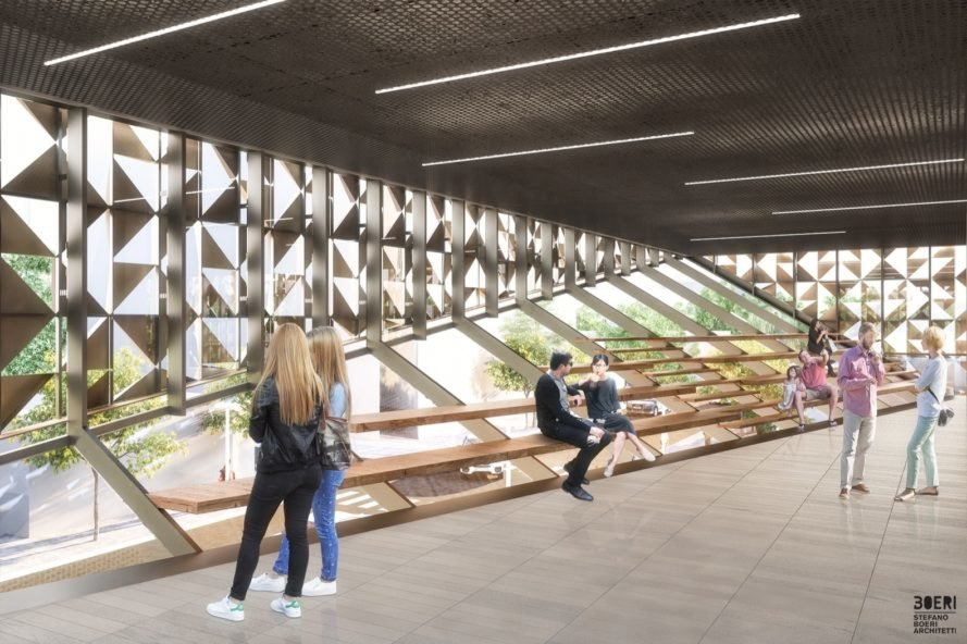 people sitting on wood stair-like benches inside room with glass walls covered partially by aluminum triangles