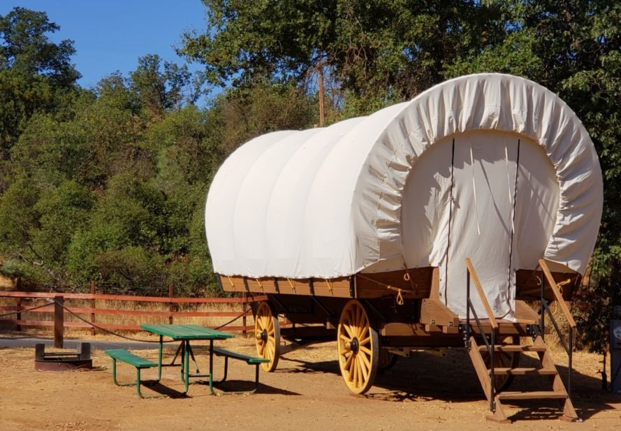 large conestoga wagon with white cover