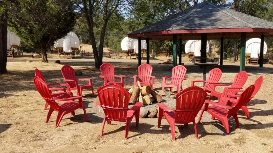 red seats around a fire pit